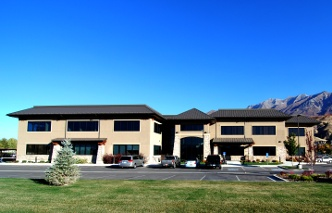 front of office with mountains in background in Orem, Utah
